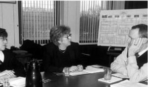 WLP's Terry Fromson (left) and Carol Tracy talking to Philadelphia Police Commissioner John Timoney about re-opened rape case files in 2002.