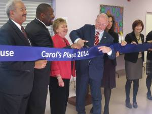 "Philadelphia Councilman Bill Greenlee cuts the ribbon at a ceremony opening ""Carol's Place."""