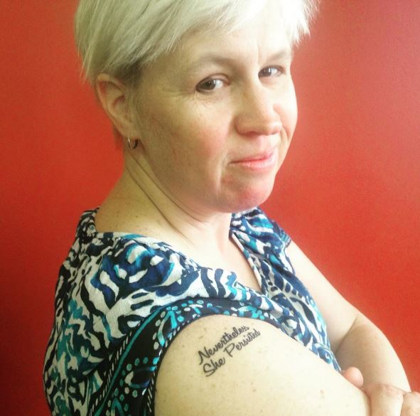 "99a441555 WLP Director of Development Jenn Nix sporting her new ""Nevertheless, She  Persisted"" tattoo."